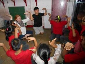 Dance activity with volunteers.