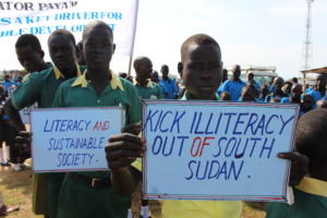 Students hold up signs at the ILD 2015 event