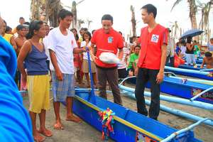 Fishing boats hand over to recipients