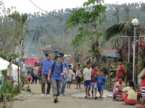 Our Team Arriving at a Storm-Ravaged Village
