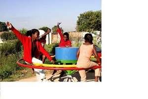 Girls spin on PlayPump Merry-Go-Round