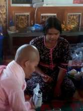 Aye Aung teaching at Buddhist monastery school