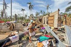 DaanBantayan resident surveys her home