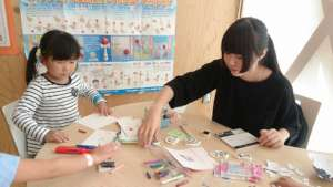 Children making bookmarks