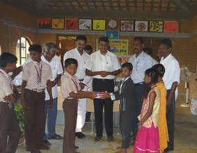 Donors distributing educational materials