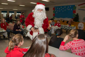 Santa bringing gifts to our campers!
