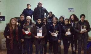 Visiting reading group in Niqozi, conflict zone