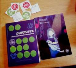 Our brand new reading group guidebook and a book