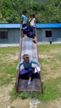 Enjoying the new slide at Gujarpa School, Lapilang
