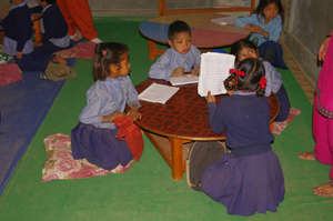 Small round tables for very young children