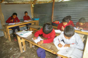 Pokhare Lower Secondary School students studying