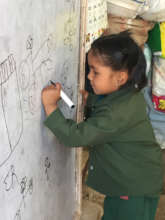 Pre-primary student practicing her writing