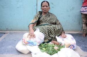 Elderly women groceries donation giving monthly