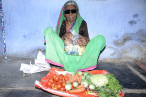 Poor old age woman getting monthly food provisions