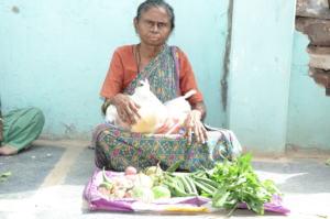 Poor senior citizen getting food provisions india