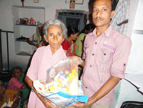 Destitute elderly person receiving monthly food