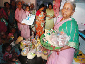 elderly woman getting monthly food donation