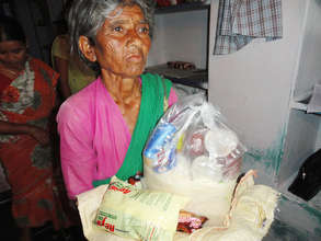 helping elderly woman by giving monthly provisions