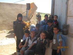 Children with L'Hussain, our water-project manager