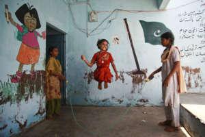 Having fun at a BRAC class in Karachi, Pakistan.