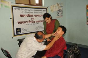 A young boy receives a thorough wellness exam.