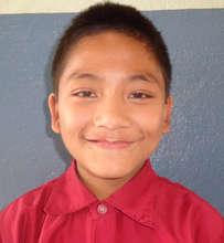 Uttam, proudly wearing his school uniform!