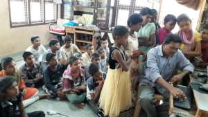 Orphan Children learning excellent computer skills