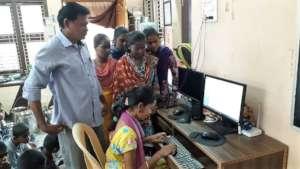 Orphan Children learning Computer Skills Training