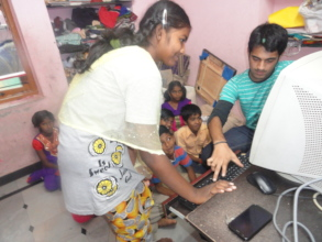 Orphanage in India children learning computer