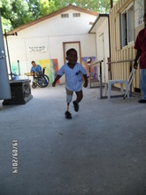 Little Jean Running with His New Prosthesis