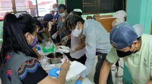 Staff, Volunteers,Young leaders help prepare lunch