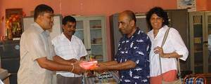 Ananda and Subadra Sirisena donating dictionaries to Thakshila P