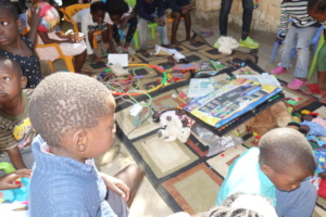 Children coloring and having fun with friends