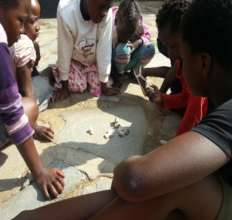 Children engaged in a traditional Zambian game
