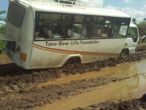 Bus stuck in the mud during the rainy season