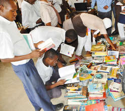 Students browsing books from the mobile library