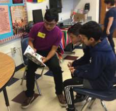 Neftali reads to 5th graders