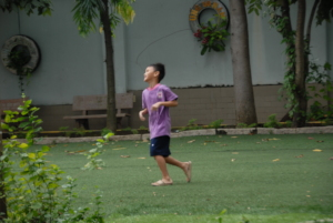 A child is jogging in the school's yard