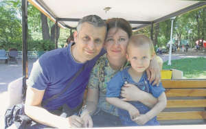 Maksym with his mom and his father Vyacheslav
