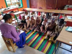 Teacher Working with Class on Reading