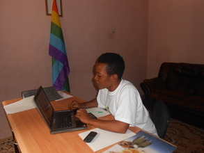 Mohamed in the office doing his daily work