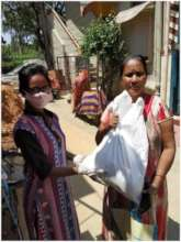 Distributing to a  grateful mother