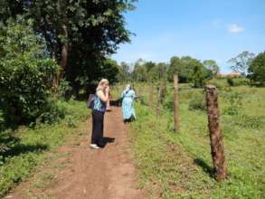 Board member Wendy looking at fenced property.