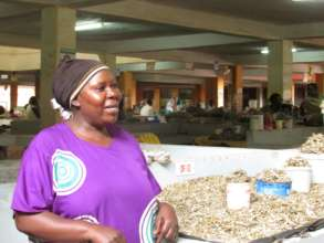 Nabatanzi at her business in May  - saving money