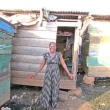Santa Outside Her Shop in Jinja Uganda