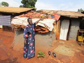 Akello Rose Shows her Roof of Plastic Sheeting
