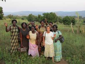Carol Davis and Jinja Women at New Land Area