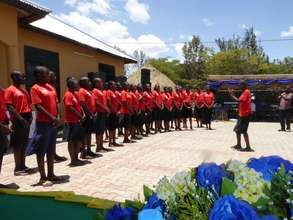 Safe House Girls singing at the opening