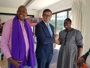 Rhobi receiving award from EU Ambassador