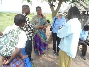 LInda Pressly (BBC) recording village meeting